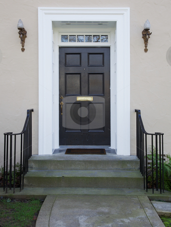 Black door angel lights stock photo, White wood bordered black door of beige stucco house by bobkeenan