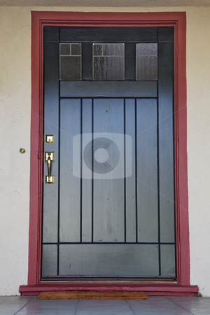 Black door burgundy trim stock photo, Craftsman deco style black wood door with burgundy trim by bobkeenan