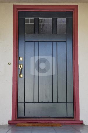 Black door burgundy trim stock photo, Craftsman deco style black wood door with burgundy trim by bobkeenan