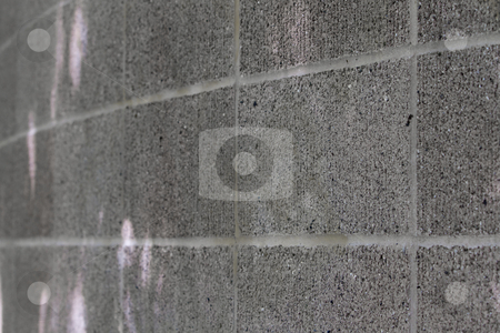Curved Concrete Wall stock photo, Curved gray close up of a concrete block wall by bobkeenan