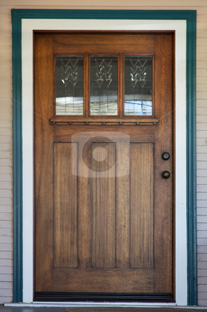 Decco glassed stained wood door stock photo, Craftsman decco style window in mission style stained wood door with green and white trip by bobkeenan