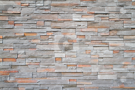 Square stone wall far stock photo, Gray, brown, red flat stone wall in a random pattern by bobkeenan