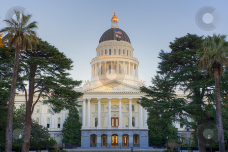 Sunligth tipped Capitol Building stock photo, Sunset shines on top dome of California state capitol building in Sacramento by bobkeenan