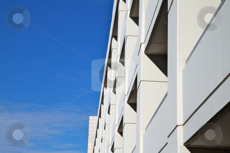 Tan Building sky clouds stock photo, Tan Building  in perspective with blue sky and clouds background by bobkeenan