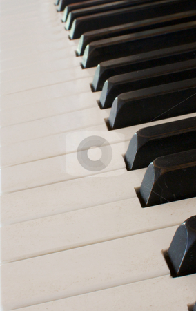 Piano keyboard at angle stock photo, a closeup of a piano keyboard at an angle with medium depth of field by bobkeenan