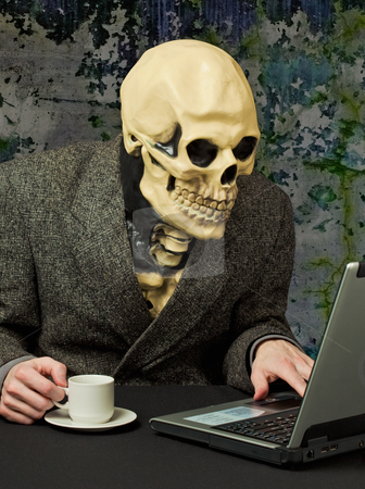 Terrible person - skeleton uses Internet stock photo, The terrible person - a skeleton uses the Internet by Alexey Romanov