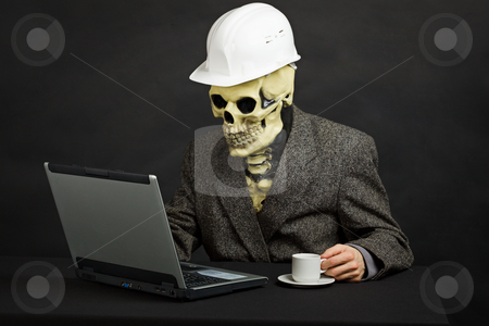 Comical man in helmet and skeleton mask with computer stock photo, The comical construction superintendent in a helmet and a skeleton mask works with the computer by Alexey Romanov