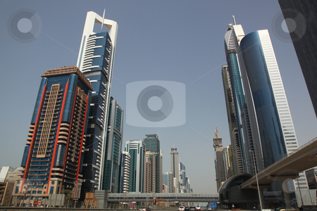 DUBAI, UAE - 2/11/2011: Business Bay Boulevard With Skyscraper B stock photo, DUBAI, UAE - 2/11/2011: Business Bay Boulevard With Skyscraper Buildings In Dubai by Nick Fingerhut