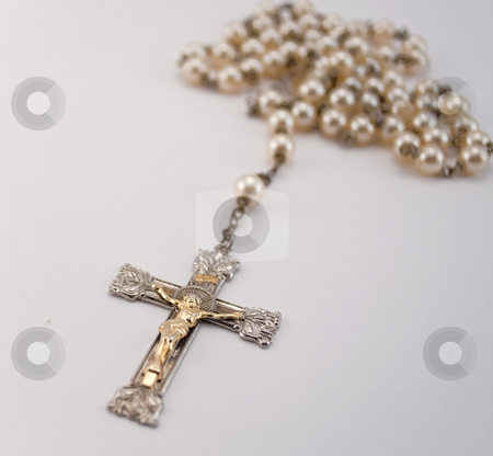 Rosary stock photo, Gold and silver rosary with pearls isolated on white by Michael T