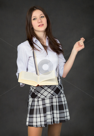 Girl with the book in hand on black stock photo, Girl with the book in hand on black background by Alexey Romanov