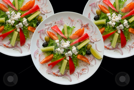 Plates with salad stock photo, Group of plates with salad on black background. by olinchuk