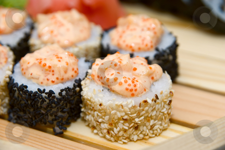 Sushi  stock photo, Close-up of of sushi on wood plate. by olinchuk