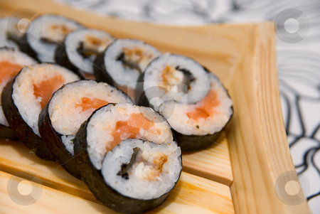 Set of sushi stock photo, Set of sushi on wood plate. by olinchuk