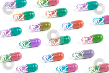 Color Pills stock photo, Color Pills isolated on white background   by olinchuk