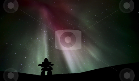 Northern light above an inukchuk in Saskatchewan stock photo, Northern light above an inukchuk in Saskatchewan by Mark Duffy