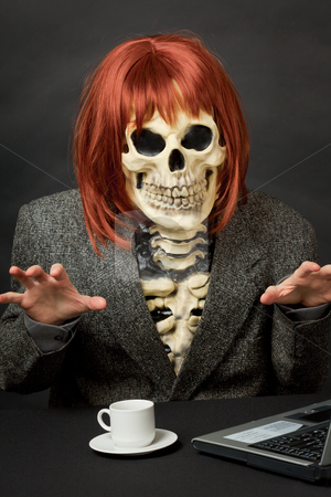 Amusing skeleton with red hair - Halloween stock photo, The amusing skeleton with red hair tries to frighten us by Alexey Romanov
