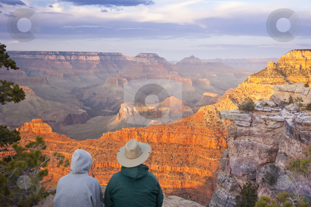 Couple Enjoying Beautiful Grand Canyon Landscape stock photo, Couple Enjoying the Beautiful Landscape of the Grand Canyon Sunset. by Andy Dean