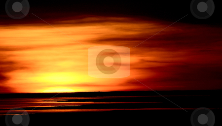 Sunset reflected off Lake Diefenbaker stock photo, Sunset reflected off Lake Diefenbaker by Mark Duffy