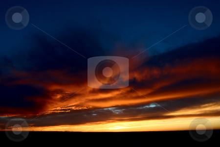 Set sun lighting up storm clouds stock photo, Set sun lighting up storm clouds by Mark Duffy