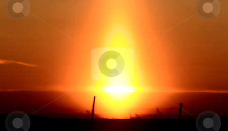 Sun flare at sunrise stock photo, Sun flare at sunrise by Mark Duffy