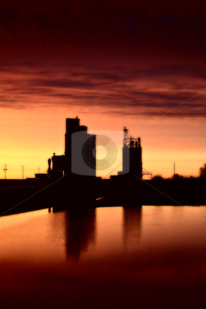 Eyebrow gain elevators reflected off water after sunset stock photo, Eyebrow gain elevators reflected off water after sunset by Mark Duffy