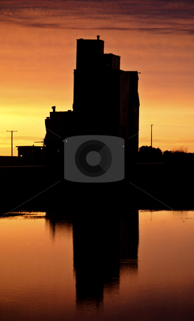 Eyebrow gain elevator reflected off water after sunset stock photo, Eyebrow gain elevator reflected off water after sunset by Mark Duffy