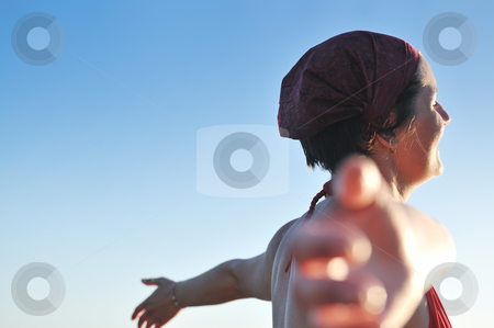 Happy girl spreading hands and enjoy in sunlight stock photo, happy girl spreading hands and enjoy in sunlight at summer vacation by Benis Arapovic
