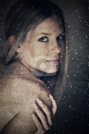 Beauty behind window with rain drops stock photo, beautiful woman with natural make-up and long hair behind glass with raindrops on grunge texture by lubavnel