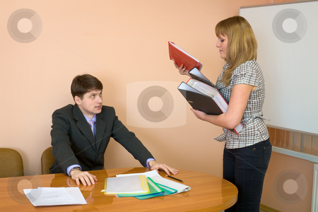Secretary gives a folders to the chief stock photo, The secretary gives a folders to the chief by Alexey Romanov