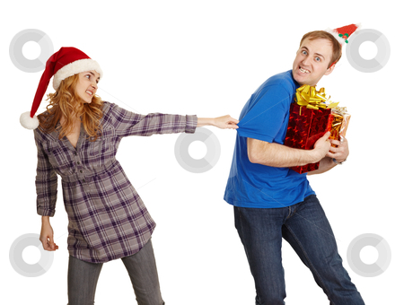 Man hides all Christmas gifts from woman stock photo, The man hides all Christmas gifts from the woman isolated on a white background by Alexey Romanov