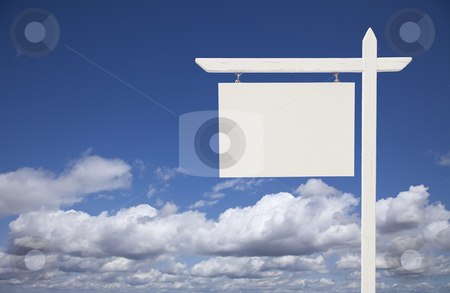Blank White Real Estate Sign Over Sky and Clouds stock photo, Blank White Real Estate Sign Over Clouds and Sky Ready For Your Own Message. by Andy Dean