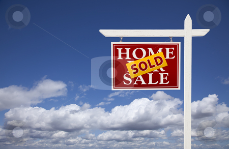 Red Sold Home For Sale Real Estate Sign Over Clouds and Sky stock photo, Red Sold Home For Sale Real Estate Sign Over Beautiful Clouds and Blue Sky. by Andy Dean