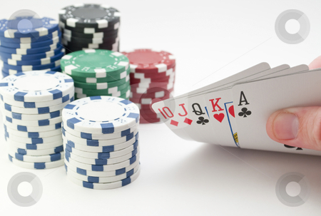 Poker Straight stock photo, Low angle shot of hand lifting up a straight with chips in the background, isolated on white. by Michael T