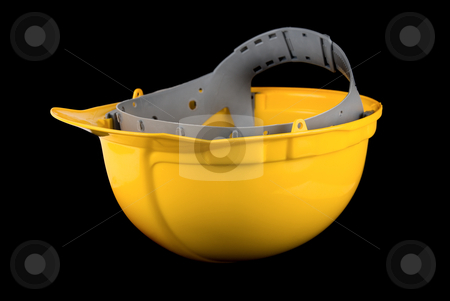 Yellow helmet stock photo, Yellow helmet isolated on a black background by olinchuk