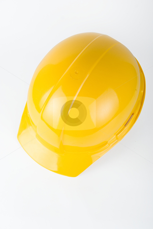 Yellow helmet stock photo, Yellow helmet closeup on a white background by olinchuk