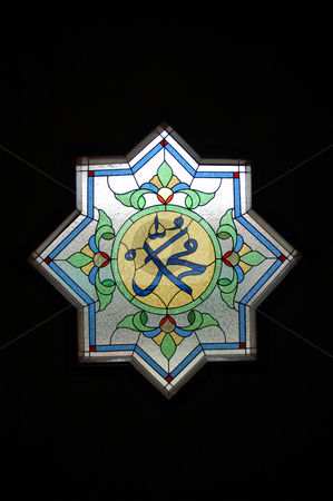 Arabic stained glass stock photo, arabic stained glass design that commonly found in masjid building by Bayu Harsa