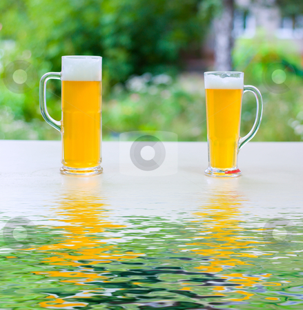 Beer consolidate stock photo, two human hands, man and woman with beer in glass. by olinchuk