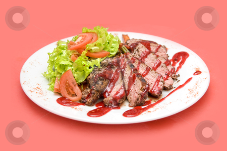 Meat  stock photo, Roasted Beef meat at cranberries sauce with vegetables by olinchuk