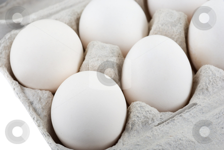 Eggs stock photo, Eggs at the container. Top view. by olinchuk