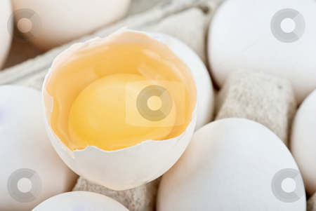 Eggs stock photo, Eggs closeup with one egg is broken by olinchuk