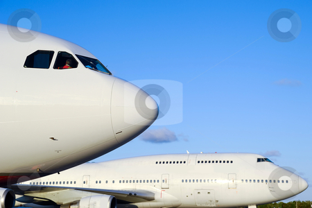 Planes in airport stock photo, Two jumbo jet planes in an airport.  by Lars Christensen