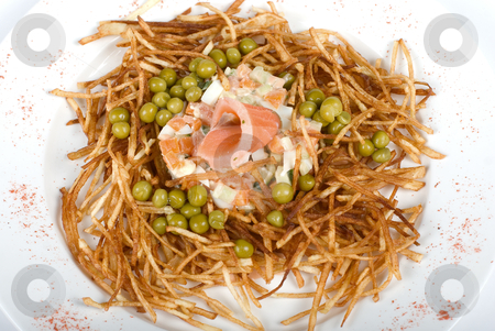 Closeup of salad with salmon fish stock photo, Closeup of salad with salmon fish at fried sliced potato with carrot and peas dressed by tomato sauce with cognac by olinchuk