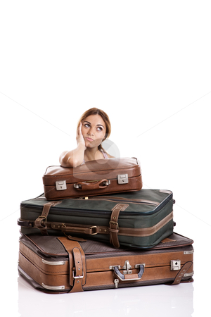 Thinking on the vacations stock photo, Beautiful young woman behind the baggage thinking on the vacations, isolated on white background by ikostudio