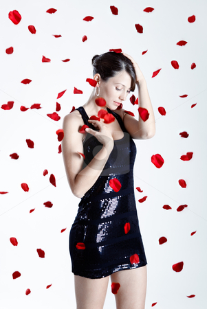 Rose petals woman stock photo, Beautiful and sexy fashion model posing with rose petals by ikostudio