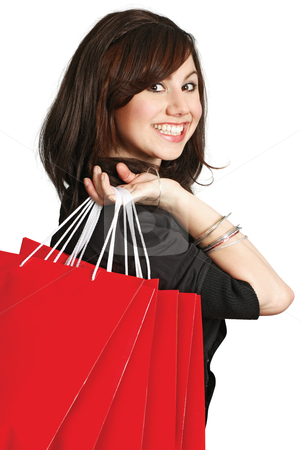 Smiling happy shopper stock photo, A very happy shopping girl holding bags and smiling wildly about her rabid consumerism.  by © Ron Sumners