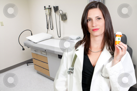 Doctor stock photo, A beautiful young female doctor on her rounds by Robert Byron