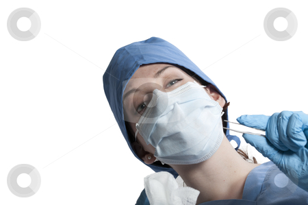 Beautiful Woman Surgeon stock photo, A beautiful young woman surgeon performing surgery by Robert Byron