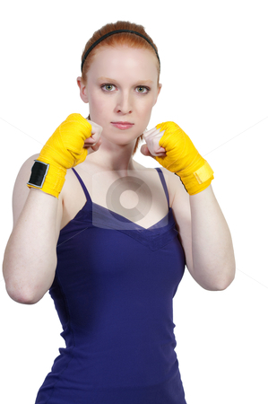 Boxing stock photo, A beautiful young woman wearing a pair of boxing gloves by Robert Byron