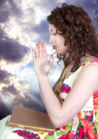 Woman praying stock photo, Beautiful Christian woman in a deep prayer by Robert Byron