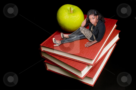 Back to School stock photo, Back to School Concept - A teacher or teenager woman sitting beside an apple on a book. by Robert Byron
